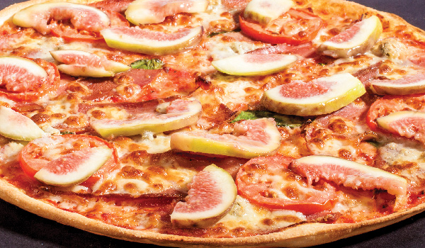 Picture of pizza with fig and tomato